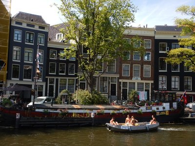 Locals were basking in the record high temperatures; with most places not having AC it was cooler outside but no one ventured swimming in the canals