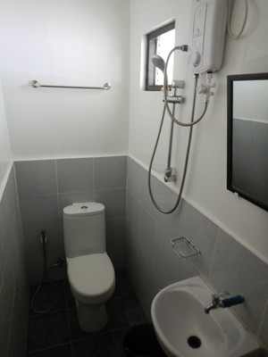 My budget lodging in Coron had an all-in-one bathroom; the room had a comfy bed and good AC so I could make do