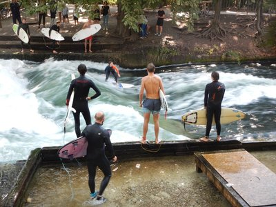 The world's best known river surfing spot, the Eisbach wave, let one surfer at a time try his or her skills for a few seconds; reminded me of bull riding except the bell never rings