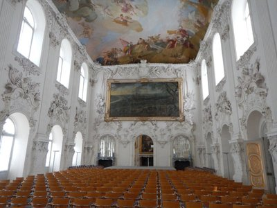 In 1722 the Venetian painter Jacopo Amigoni created what was at the time the largest ceiling painting in the world in the Large Hall of the New Palace