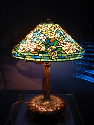 Conventional Cushion Base (ca. 1900-06) with Rose Shade (ca. 1900-06); the Gallery of Tiffany Lamps featured 100 illuminated Tiffany lamps from a spectacular collection, displayed within a dramatically lit jewel-like space