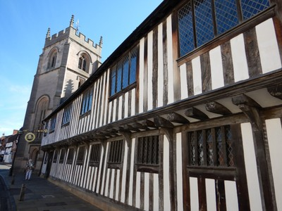 The Guildhall and Shakespeare's grammar school; in the late 1500s traveling players performed regularly at the Guildhall providing Shakespeare with his first experience of professional theater
