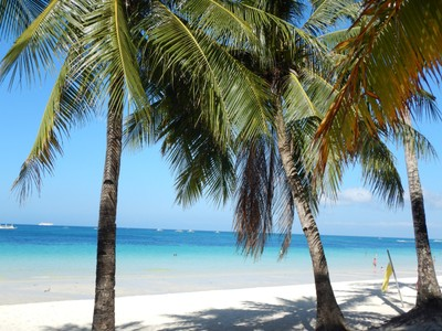 Almost all visitors arrive to Boracay by flying into Caticlan airport which is tiny and on Panay island; you then take a trike to the ferry for the 15 minute bangka crossing and then another trike to your Boracay hotel