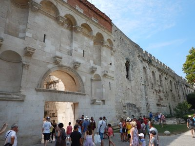 The Golden Gate is the main land side entrance to Diocletian's Palace; the palace is a very crowded UNESCO World Heritage Site