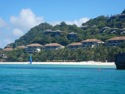 There are quiet beaches on the island such as Diniwid Beach; it looks more upscale and may not even have roosters!