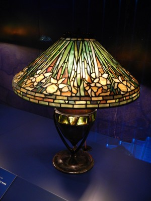 Crutch Oval Base with Turtleneck Tile Base with Daffodil Shade (both ca. 1900-06); Tiffany won a gold medal with his stained glass windows The Four Seasons at the Exposition Universelle (1900) in Paris
