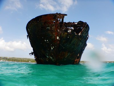 This Greek cargo ship ran aground more than 30 years ago near Rocky Cay; it was easy to swim out and explore; pieces of the ship were scattered on the sea floor