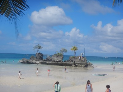 Willy's Rock is one of the most photographed spots on Boracay; it's a tidal island with a statue of the Virgin Mary atop steps carved into the volcanic rock
