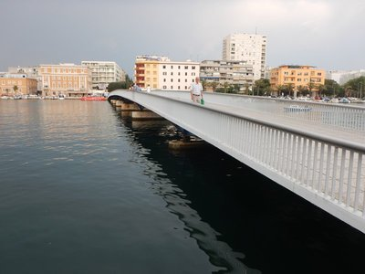 The old pedestrian bridge connecting the historic center to the more modern part of Zadar was destroyed in World War 2; Zadar is the oldest continuously inhabited Croatian city