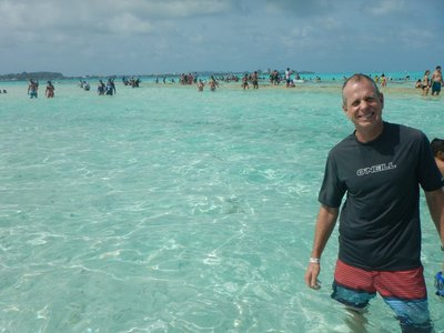 The sandbar, El Acuario, is in the background; since there was no room on it people would leave their bags with an attendant and walk across the water to Haynes Cay