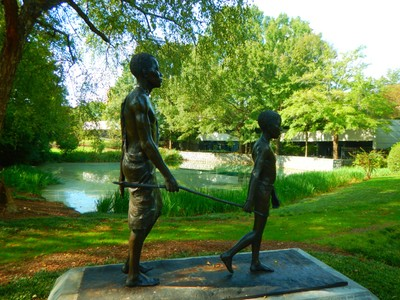 This sculpture was given to the Carter Center in recognition of Carter's efforts to eradicate river blindness in Africa; the disease is spread by black flies but the Carter Center has worked to provide medication to combat this disease
