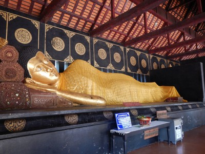 The reclining buddha at Wat Chedi Luang; tuk tuks were a very affordable way to get around with old city fares of about $3 per trip