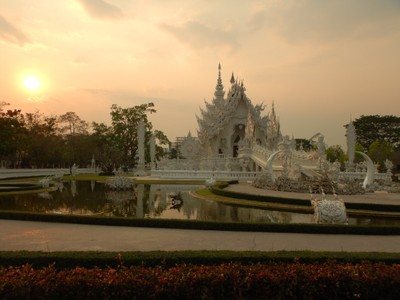 The White Temple is a contemporary, unconventional, privately-owned art exhibit in the style of a Buddhist temple in Chiang Rai Province; it is owned by Chalermchai Kositpipat, who designed, constructed, and opened it to visitors in 1997