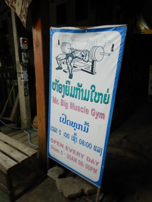 See if you can decipher Laotian symbols; the gym was an open-air storefront but several people were in there biking, on the treadmill and lifting weights