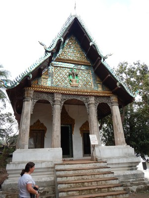Wat Pa Phai; one of the oldest temples in the city dating from either 1645 or 1815 that has ornate murals inside reflecting sequences from the lives of ordinary Laotian people