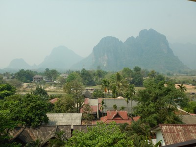 The view of the karst landscape from our hotel balcony; significant expansion of Vang Vieng and its infrastructure occurred during the 1964-73 Vietnam War when the US constructed an air force base here