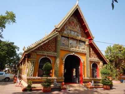 Wat Si Muang is famous for bringing good luck and wealth, particularly to those trying to have children; the elaborate wood carvings and bright colors made it seem quite whimsical