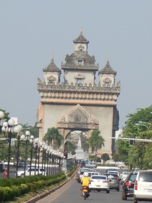 The Patuxai monument is a replica of the Arc de Triomphe and officially called the Victory Gate; it was built in the 1960s with cement donated by the US intended for the construction of a new airport