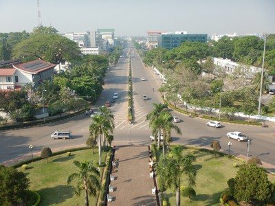 View from top of Patuxai monument; Vientiane was the administrative capital during French rule and, due to economic growth in recent times, is now the economic center of Laos; the city had a population of 820,000 as of the 2015 census