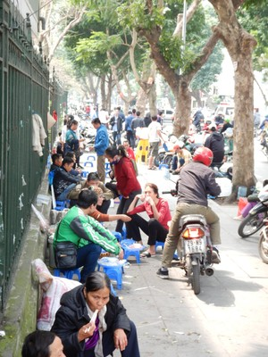 One reason it's so difficult to get around in Hanoi is people sit down to eat street food and motorcycles use them as parking lots; I found it better to walk on the edge of the road