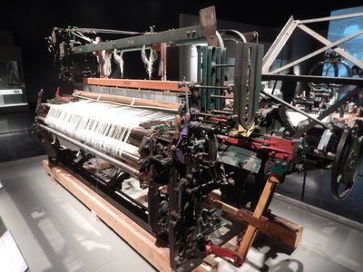 1915 weaving machine to make sheets; textile production peaked here during WW2 but most firms went bankrupt in the 1980s and closed for good