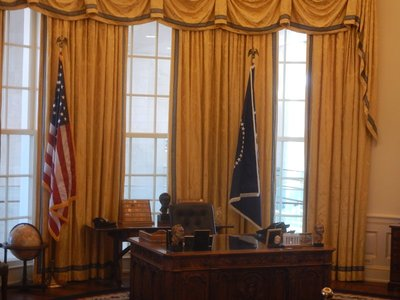 Replica of Clinton's desk in the Oval Office; after years of poor eating habits, Clinton became a vegan after suffering a heart attack