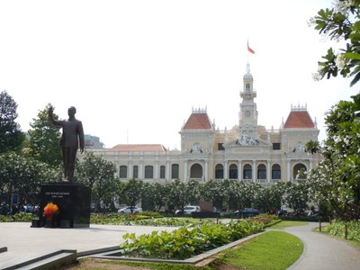 A statue of Ho Chi Minh with city hall in the background; the beautiful structure was built in 1902-1908 in a French colonial style for the then city of Saigon