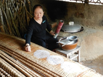 This woman is making traditional rice paper that was used to wrap around food much like a tortilla; there were numerous employees, like her, that demonstrated trades and skills used during the war