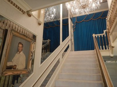 The white staircase leads to the second floor where Elvis and Lisa Marie had their bedrooms; it would be interesting to see what Elvis wore when not performing