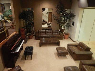 Lounge adjacent to racquetball court; Elvis played his final songs on that piano, Unchained Melody and Blue Eyes Crying in the Rain
