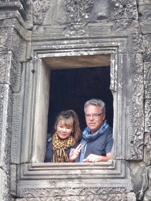 Canadians Debbie and Craig at Bayon temple which is in the center of Angkor Thom; built in the late 12th or early 13th centuries, it was the official state temple of the king