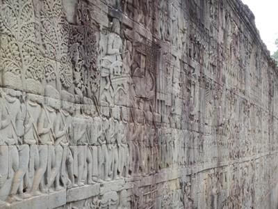 The outer gallery at Bayon temple features a series of bas-reliefs depicting historical events and scenes from everyday life of the Angkorian Khmer; all of the Angkor temples had incredibly detailed stone carvings on most every surface
