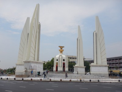 The Democracy Monument was built in 1939 to celebrate the 1932 coup that ended the 150 year absolute monarchy; it was a challenge to consume enough liquids to make up for the sweat constantly dripping off me