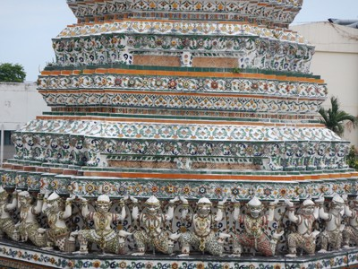 The colored mosaic pieces at Wat Arun are Chinese porcelain and create a gorgeous work of art; the temple was a popular place for photographers and just across the river from the Royal Palace
