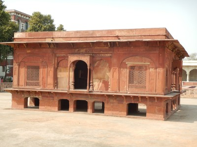 This structure (1842) at the Red Fort stands in the middle of a pre-existing water tank; made out of red sandstone, which was cheaper than white marble, it originally had a red sandstone bridge, which was probably lost after the Indian Rebellion of 1857
