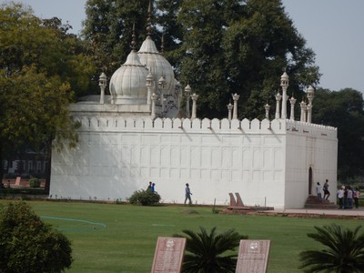 The Pearl Mosque (1659) at the Red Fort is a small, three-domed structure carved in white marble, with a three-arched screen leading down to the courtyard; it is no longer open to the public