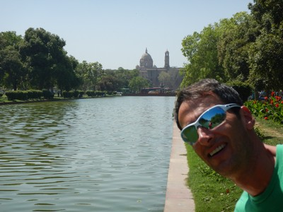Jonathan is laughing at the thought that he would like visiting India; this pool is on their national mall but behind me are men doing their laundry in it