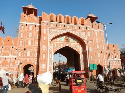 The Chandpole Gate is one of several leading into the Pink City; the gate is used by all as you can see by the tuk-tuk, bicycle powered wagon and even the goats