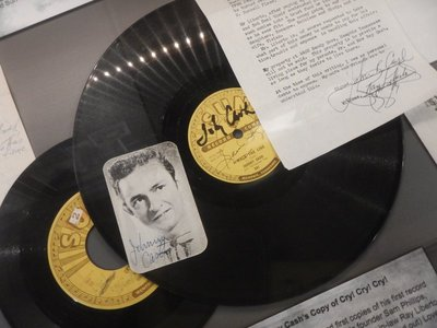 Original 78 RPM album of I Walk the Line signed by Cash and Sun Records founder Sam Phillips; he went on to record over 1500 songs in his career