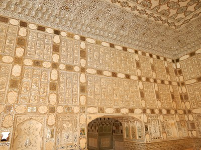 Sheesh Mahal at the Amber Fort where the mirror mosaics and colored glasses were called a glittering jewel box in flickering candlelight when it was built in 1727; I loved the detail and workmanship