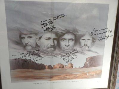 Print featuring the autographed opening lyrics of each member of the Highwaymen; during this same period Cash appeared in several TV movies and even made a guest appearance on The Muppet Show