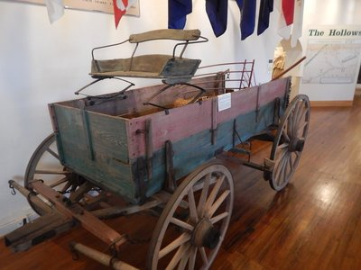 Nissen farm wagon from the late 1800s with comfortable spring seat; they were used for farm tasks during the week and to bring the family to town on Sunday
