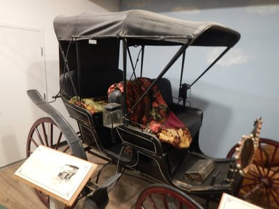 This restored 1890s buggy originally sold for less than $100; they were used on the dirt roads to transport people, luggage and goods from the train depot