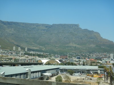 The main feature of Table Mountain (3563 ft) is the level plateau approximately 2 mi from side to side, edged by impressive cliffs; Table Mountain is the only terrestrial feature to give its name to a constellation