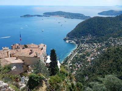 The town of Eze sur Mer lies at sea level and is connected by train to Nice and Monaco; Cap Ferret is the peninsula in the distance