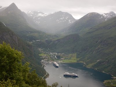Ornesvingen viewpoint looking towards Geiranger; several large cruise ships per day call on tiny village
