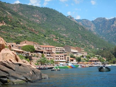 The remote town of Porto is built along one main road starting up on the mountain and continuing down to the riverside