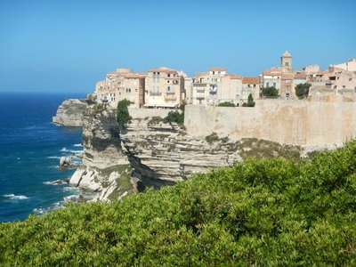 The old town is 230 feet above the water; the chalk-white limestone cliffs have been undercut by the sea so it appears the buildings overhang it