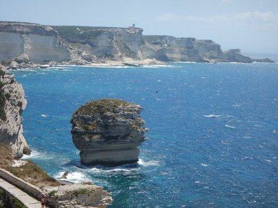 The famous solitary stack called Grain of Sand broke off from the cliff 800 years ago; there are more tourists here than locals