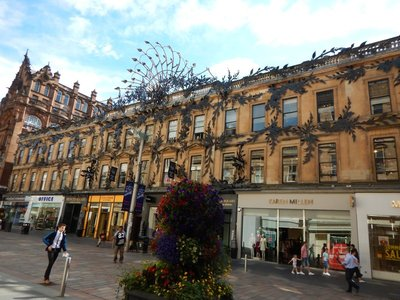 Old building has been updated with steel peacocks and foliage; Scotland is very pro-EU and anti-Trump